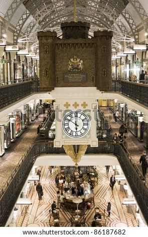 SYDNEY, AUSTRALIA - JULY 1: A hanging clock inside the Queen Victoria Building shows time on July 1, 2011 in Sydney. The QVB is a high-end shopping precinct in Sydney and a famous tourist attraction. - stock photo