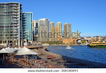 Sydney, Australia - July 17, 2014:  Circular Quay Restaurants & Bars Viewed from The steps of the Sydney Opera House  - stock photo