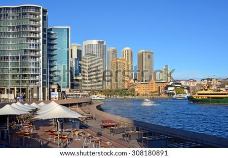 Sydney, Australia - July 17, 2014:  Circular Quay Restaurants & Bars Viewed from The steps of the Sydney Opera House  - stock photo