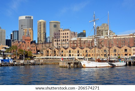 Sydney, Australia - July 18, 2014: Historic sailing ship moored at Circular Quay with the Rocks & CBD restaurants & buildings in the background. - stock photo