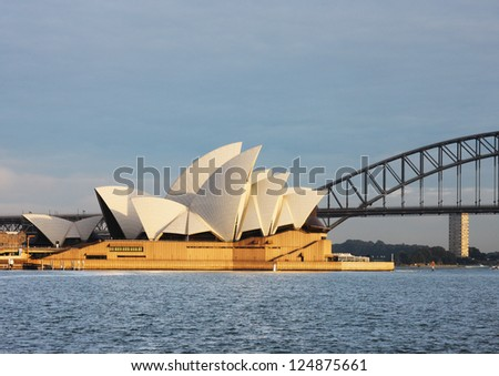 SYDNEY, AUSTRALIA - JULY 10 : Sydney Harbour Bridge that carries rail, vehicular, bicycle and pedestrian traffic and Sydney Opera House, a multi-venue arts center. Picture taken on July 10, 2012.