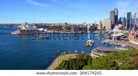 Sydney, Australia - July 18, 2014:  Sydney Harbour, Circular Quay & Opera House Panorama taken from the top of the Harbour Bridge. - stock photo