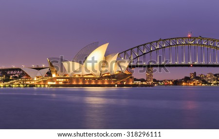 SYDNEY, AUSTRALIA, 10 JULY 2015 - Sydney opera house and Harbour bridge in Sydney at sunset. Iconic and world famous landmark of Australia viewed from Mrs Macquary point in Royal Botanic Garden - stock photo