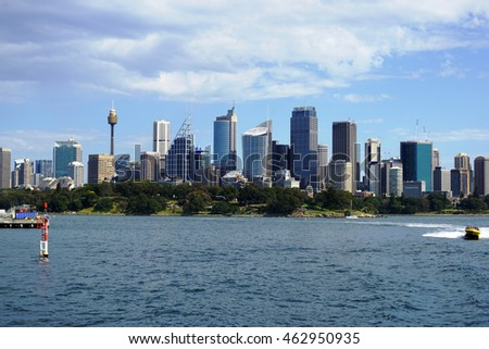 SYDNEY, AUSTRALIA - JUNE 20, 2016:: Sydney city CBD towers and office buildings above Royal botanic garden across Harbour waters on a sunny day.