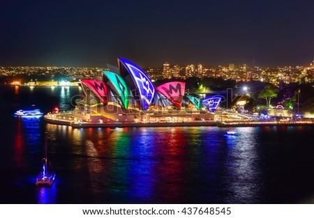 SYDNEY, AUSTRALIA - June 15, 2016, Sydney Opera House and reflection illuminated with colourful light design imagery, during the Vivid Sydney 2016 annual public event.