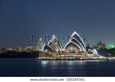 Sydney, Australia - June 12, 2014: Sydney opera house at night. One of Sydney most popular destinations for leisure and entertainment. It was designed by Danish architect Jorn Utzon. - stock photo