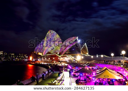 SYDNEY, AUSTRALIA - JUNE 5, 2015; Sydney Opera House illuminated with colourful light design imagery, during the Vivid Sydney 2015 annual public event.