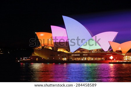 SYDNEY, AUSTRALIA - JUNE 2, 2015;   Sydney Opera House in bold dynamic colourful patterns for Vivid Sydney annual festival event. Prominant colours of orange pink, blue and green