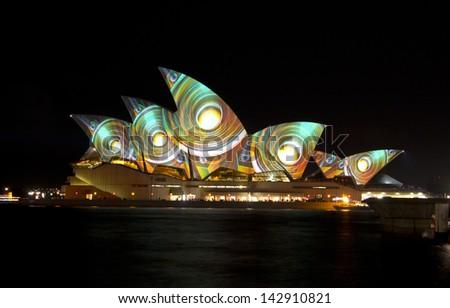 SYDNEY, AUSTRALIA - June 09: Sydney Opera House shown during Vivid Sydney: A Festival of Light, Music & Ideas on June 09, 2013 in Sydney, Australia. - stock photo