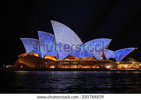 SYDNEY, AUSTRALIA - JUNE 2, 2014;  Sydney Opera House with architectural blueprint design during Vivid Sydney annual festival of light, music and ideas