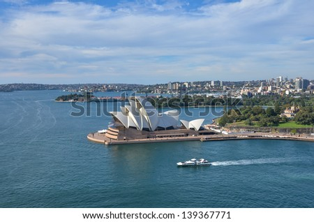 SYDNEY, AUSTRALIA - JUNE 7: The Sydney Opera House is a multi-venue performing arts centre other than a symbol of both Sydney and the Australian Nation. SYDNEY, AUSTRALIA, June 7, 2011. - stock photo