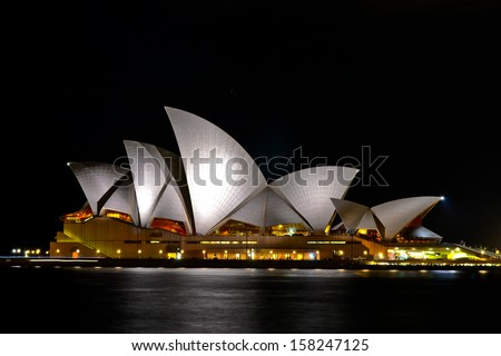 SYDNEY, AUSTRALIA - 1 JUNE 2013: The Sydney Opera House is being illuminated during night time - stock photo