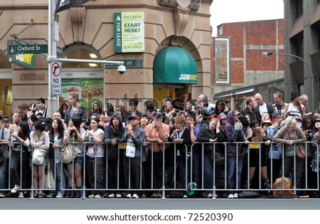 SYDNEY, AUSTRALIA - MARCH 5: Crowded people at mardi gras parade on March 5, 2011 in Oxford Street, Sydney, Australia. Mardi gras is an annual event for gay/lesbian acceptance in Sydney. - stock photo