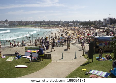 Sydney, Australia-March 16th 2013: Bondi Beach viewed from the north on a busy holiday weekend. The beach is one of Australia's most famous and is listed in the Australian National Heritage List. - stock photo
