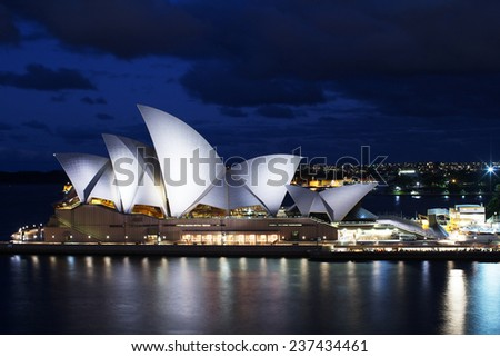 SYDNEY, AUSTRALIA - 04 March  2013: The Sydney Opera House is being illuminated during night time - stock photo