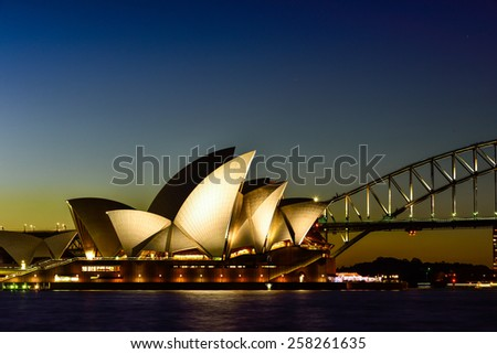 SYDNEY AUSTRALIA - March 6, 2015 : View of sunset at Sydney Opera House on March 6 in Sydney, Australia. Over 10 millions tourists visit Sydney every year - stock photo