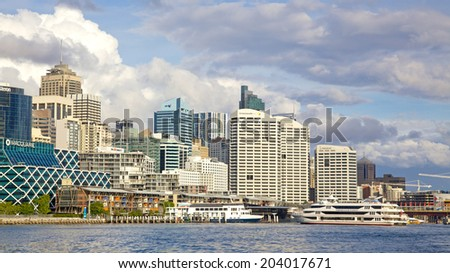 SYDNEY, AUSTRALIA - MAY 20, 2010: Apartment and office blocks overlook Darling Harbour, a harbour and recreational and pedestrian precinct adjacent to the city centre of Sydney in New South Wales.
