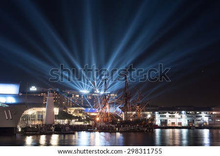 SYDNEY, AUSTRALIA - MAY 30, 2015; Immersive light installations and projections from the roof of the Star City Casino in Darling Harbour during Vivid Sydney festival.   - stock photo