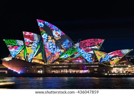 Sydney, Australia - May 27, 2016: Lighting the Sails Songlines is Sydney Opera House illumination on annual outdoor lighting festival Vivid Sydney - stock photo