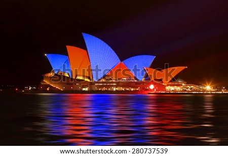 SYDNEY, AUSTRALIA - MAY 22, 2015; Sydney Opera House illuminated with red and blue sails imagery during the Vivid Sydney 2015 annual public event. - stock photo