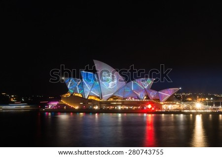Sydney, Australia - May 23, 2015: Sydney Opera House illumination Lighting the Sails. Part of annual Vivid Sydney: A Festival of Light, Music & Ideas. Long exposure. Circular Quay