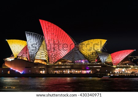 Sydney, Australia - 2016, May 27: Sydney Opera House illumination Lighting the Sails Songlines as part of annual outdoor lighting festival Vivid Sydneys - stock photo