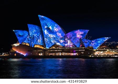 Sydney, Australia - 2016, May 27: Sydney Opera House illumination Songlines created by four aboriginal artists. Annual outdoor lighting festival Vivid Sydney - stock photo