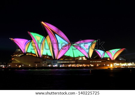 SYDNEY, AUSTRALIA - MAY 25: Sydney Opera House shown during Vivid Sydney: A Festival of Light, Music & Ideas on May 25, 2013 in Sydney, Australia. - stock photo