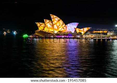 SYDNEY, AUSTRALIA - MAY 27: Sydney Opera House shown during Vivid Sydney: A Festival of Light, Music & Ideas on May 27, 2014 in Sydney, Australia.  - stock photo