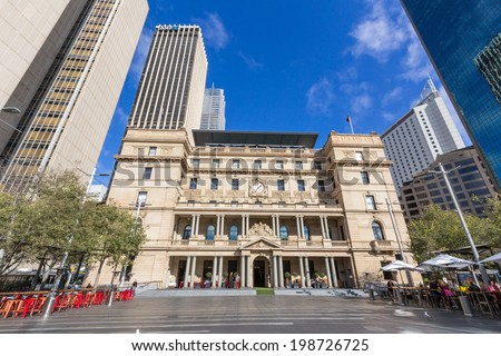 SYDNEY, AUSTRALIA - MAY 30, 2014: The Customs House is an historic Sydney landmark located in the city's Circular Quay area. This building served as the headquarters of the Customs Service until 1990. - stock photo