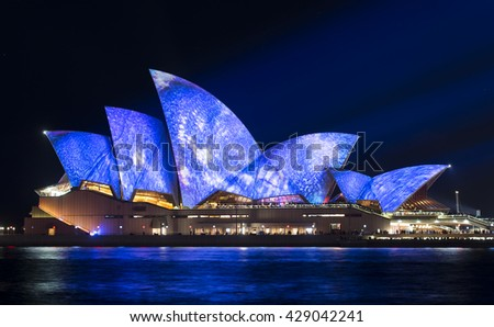 Sydney, Australia - May 30, 2016: The Sydney Opera House has a colorful design projected onto its sails at night as part of the Vivid Sydney festival.