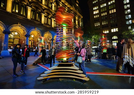 SYDNEY, AUSTRALIA - MAY 26, 2013;  Visitors interact with Robotanic in Martin Place, Sydney. When touched light and soothing chimes of nature sound.  Artist:  Thomas Martin / Sebastian Barkoczy - stock photo