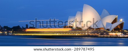 Sydney, Australia - Nov 21, 2011: The beautiful night scene of Sydney Opera House. Long exposure cause the sea surface looks smooth.  - stock photo