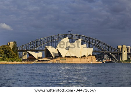 SYDNEY, AUSTRALIA, 22 NOVEMBE 2015 - Sydney opera house and Harbour bridge in Sydney at sunrise. Iconic and world famous landmark of Australia viewed from Mrs Macquary point in Royal Botanic Garden - stock photo