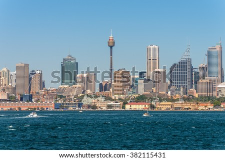 SYDNEY, AUSTRALIA - NOVEMBER 9, 2014: Australian Sydney landmark - city CBD high rises and towers forming megapolis cityscape summer day from harbor, Sydney, New South Wales, Australia.
