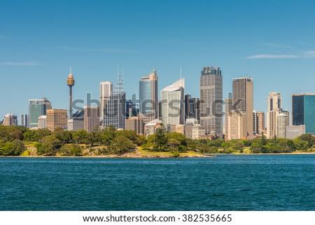 SYDNEY, AUSTRALIA - NOVEMBER 9, 2014: Australian Sydney landmark - city CBD high rises and towers forming megapolis cityscape summer day from harbor, Sydney, New South Wales, Australia. - stock photo