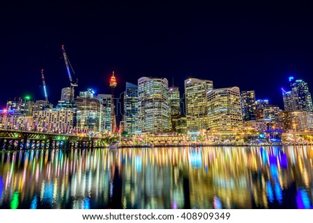Sydney, Australia - November 10, 2015: Darling Harbour skyline view at night time. Long exposure camera settings applied.
