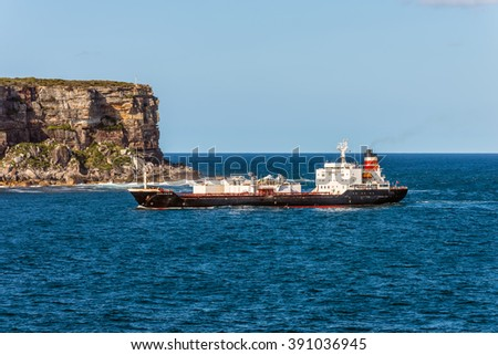 SYDNEY, AUSTRALIA - NOVEMBER 12, 2014: Goliath cement carrier ship navigating west into Sydney Harbour, Sydney, New South Wales, Australia. On the background is North Head and the Pacific Ocean.