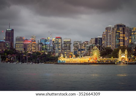 Sydney, Australia - November 7, 2015: Night view of Luna Park with office buildings in background. Long exposure settings - stock photo