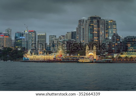 Sydney, Australia - November 7, 2015: Night view of Luna Park with office buildings in background. Long exposure mode - stock photo