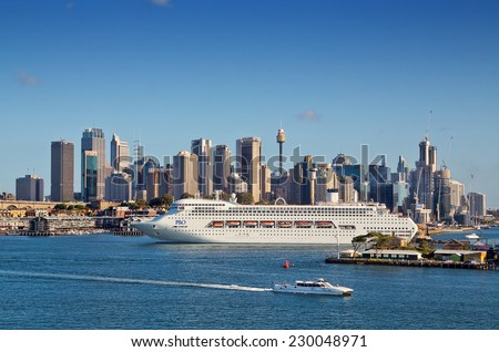 SYDNEY,AUSTRALIA - NOVEMBER 7,2014: The P&O cruise liner Pacific Jewel is guided out to sea by a tug boat at the start of a cruise to Vanuatu and New Caledonia.