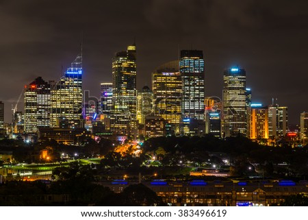 SYDNEY, AUSTRALIA - NOVEMBER 10, 2014: Unusual night view of Sydney central business district. Royal Botanic Gardens in the center, Sydney, New South Wales, Australia