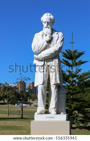 SYDNEY, AUSTRALIA - October 14, 2016: Live size marble statue of Charles Dickens in Centennial park Sydney. This is one of three statues in the world of the English novelist and social commentator.