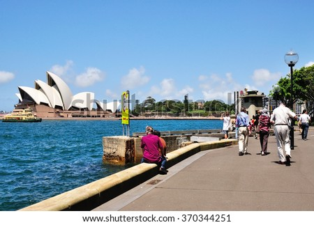 SYDNEY, AUSTRALIA - OCTOBER 19, 2015: Tourists at The Iconic Sydney Opera. Sydney Opera house is considered as the major landmark of Sydney and tourists attraction. - stock photo