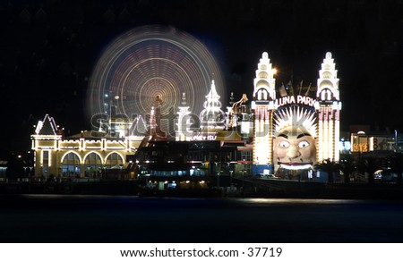 Sydney, Australia's Luna Park amusement park at night. - stock photo
