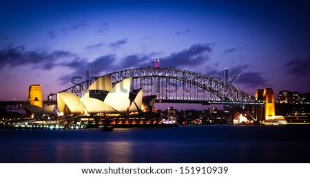 SYDNEY, AUSTRALIA - SEPT 1 : Sydney's most famous icons, the Sydney Opera House and Harbour Bridge  The Opera House celebrate its 40th anniversary in 2013 - September 1, 2007in Sydney, Australia. - stock photo