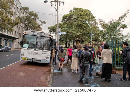 SYDNEY,AUSTRALIA - SEPTEMBER 7, 2014: A courtesy bus waits to take worshippers to Hillsong Church. Around 30,000 people attend services on its Australian campuses each week.