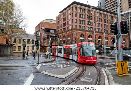 SYDNEY,AUSTRALIA - SEPTEMBER 7,2014: A tram on the light rail network nears Central Station. A $1.6B expansion of the network is currently under way. - stock photo