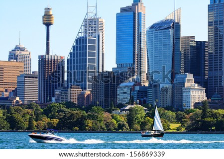 SYDNEY AUSTRALIA - SEPTEMBER 30, 2007:  Speed boat and yacht on Sydney Harbour, with backdrop of city of Sydney including Centrepoint Tower and Hyde Park