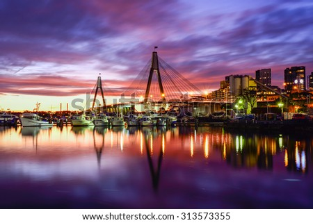 SYDNEY, AUSTRALIA - September 6, 2015: Sunset view at Anzac bridge in Sydney, Australia. This cable-stayed bridge was opened in December 1995 and have length of 805m. - stock photo